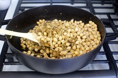 add drained chickpeas, spices, zest