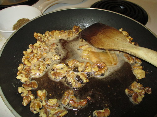 Walnuts toasting in unhealthy amounts of brown butter.