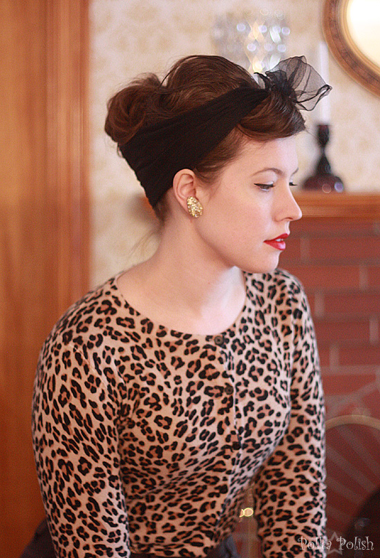 Leopard print sweater and a messy bouffant hairdo
