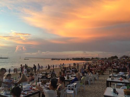 Beach dining in the tourist hotspot of Jimbaran while watching the sun set