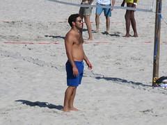 Shirtless man playing volleyball at the Atlantic Ocean beach on LBI Long Beach Island, New York