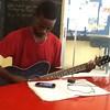 Samedi 21 Mars 2015, Luciano joue également à la guitare dans la classe de musique