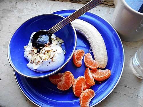 greek yogurt with jam and sliced almonds, banana, and cutie