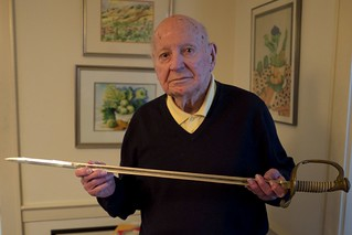 "Linwood ""Tick"" Thumm displays a sword March 11, 2015, at his home in Norfolk, Va. Thumm, a former Coast Guard officer, received the sword as a gift from his crew after they served in both the Atlantic and Pacific theaters during World War II."