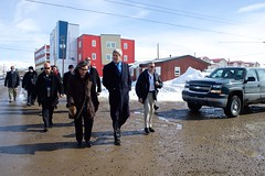 U.S. Secretary of State John Kerry walks with Arctic Council Chairman Leona Aglukkaq of Canada through her hometown of Iqaluit, Canada, just below the Arctic Circle, on April 24, 2015, amid meetings of the Arctic Council, whose chairmanship the United States will assume the next two years. [State Department Photo/Public Domain]