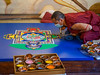 Monk works on Sand Mandala Green Tara (1 of 1)