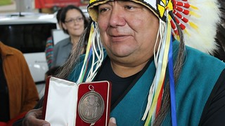 first_nations_-_as-_chief_barry_kennedy_of_carry_the_kettle_first_nation_holds_historic_treaty_4_medal_-_sept_2014