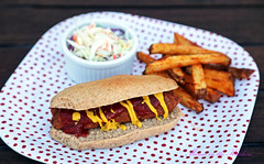 A Homemade Vegan Hot Dog on a Whole Wheat Bun, Cole Slaw and Baked Fries Please