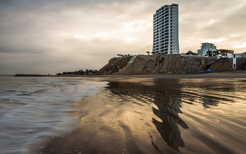 reflection beach sunrise golden ecuador sand waves tide seafoam puntabarandua