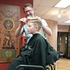 H getting his first haircut in a looong time from his cousin Rodney Acton.