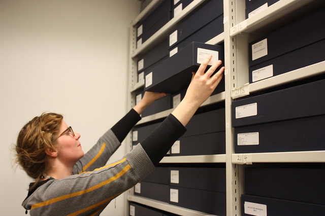 A member of staff retrieving a box of designs from the ROH Collections store