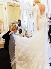 veil(0.0), bridal veil(0.0), groom(0.0), bride(1.0), bridal clothing(1.0), textile(1.0), gown(1.0), wedding(1.0), woman(1.0), formal wear(1.0), wedding dress(1.0), dress(1.0), ceremony(1.0),