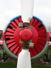wheel(0.0), vehicle(1.0), red(1.0), mechanical fan(1.0), propeller(1.0), aircraft engine(1.0),