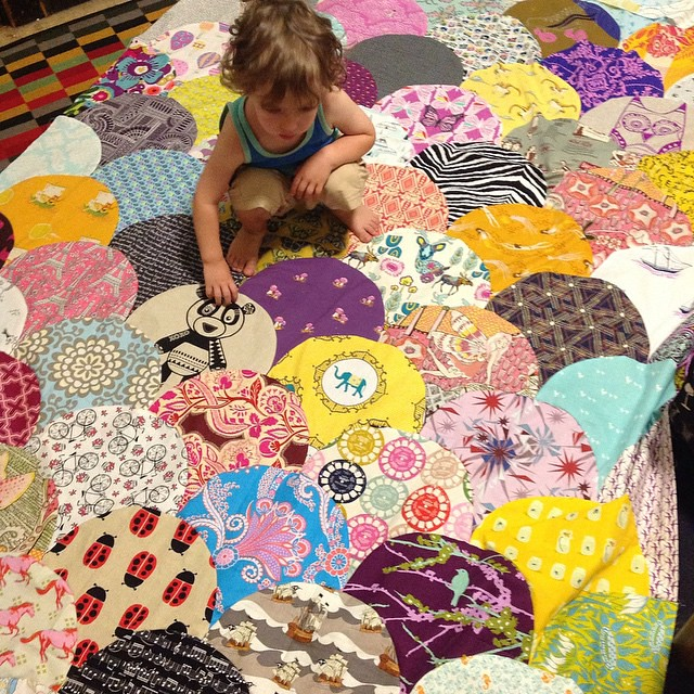 Little mister likes the #catandvee panda panel the best on his sisters quilt #useallthegoodstuff #glamclamquilt