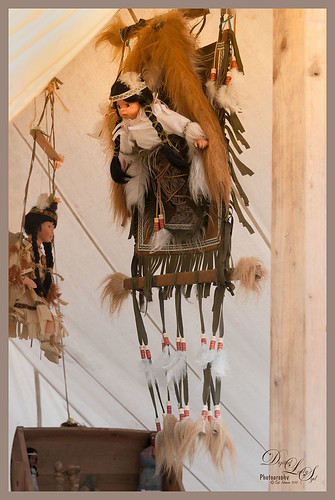 Image of a Native American Doll in a papoose