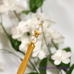 white pearl with gold accents