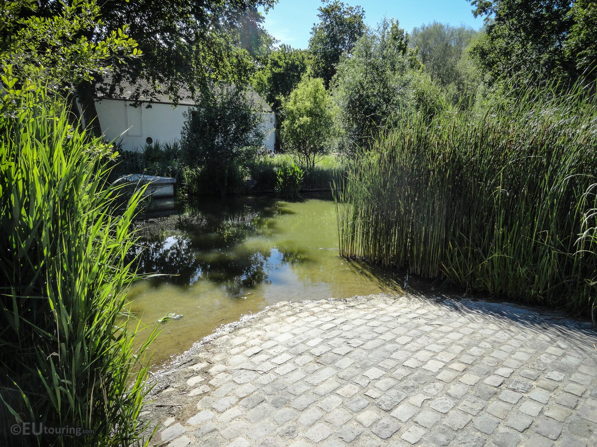 Lake beside Agence Parisienne du Climat