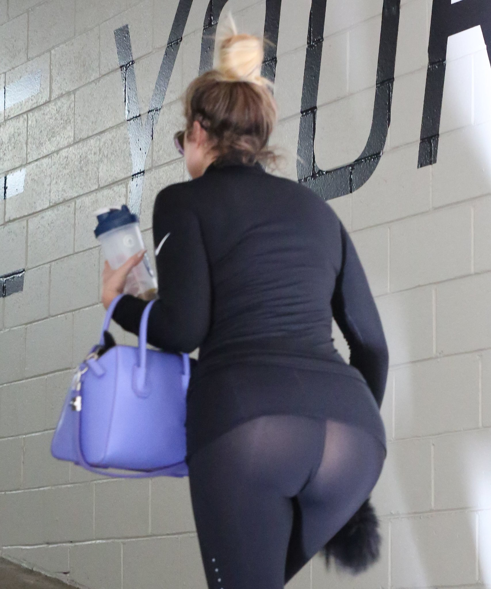 khole kardashian's booty is out again- headed to the gym 3/25/15 hq