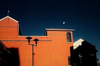 Sunlit bricks and deepened sky