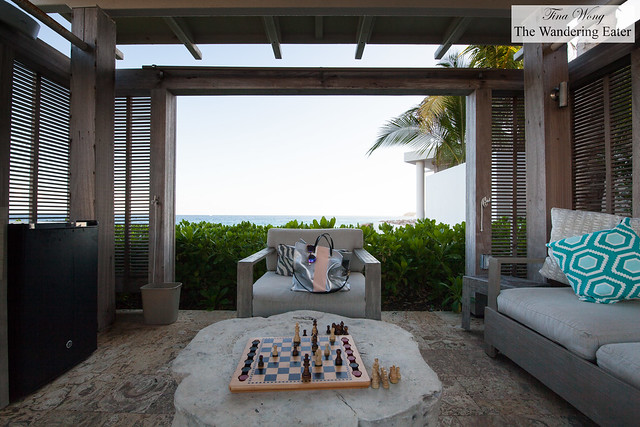 Playing chess in the cabana and a peek of the beach