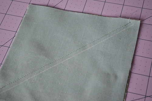 "HSTs 3: Sew 1/4"" seam along one side of line"