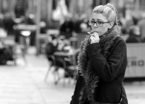 street uk urban bw woman white black girl monochrome wales photography prime mono glasses nikon candy candid coat cymru cardiff streetphotography 85mm sugar caerdydd sweets nikkor unposed spectacles primelens d7000 justard justardcom