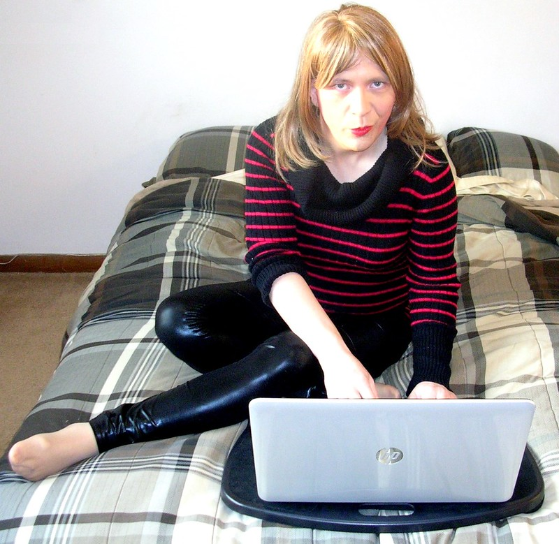 Relaxing in front of the laptop in sweater and leggings