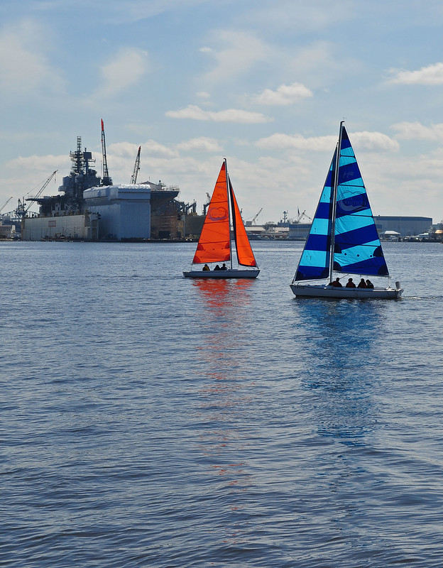 Sailboats and Aircraft Carrier
