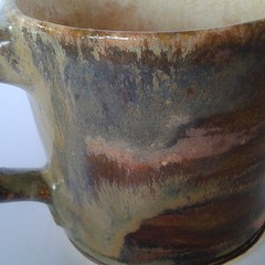 jug(0.0), pitcher(0.0), saucer(0.0), art(1.0), pottery(1.0), drinkware(1.0), tableware(1.0), mug(1.0), ceramic(1.0),