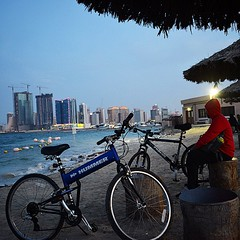 #bicycles on the #Manama #coast #beach #riders #sport #water #sea #buildings #skyline #rest #relax