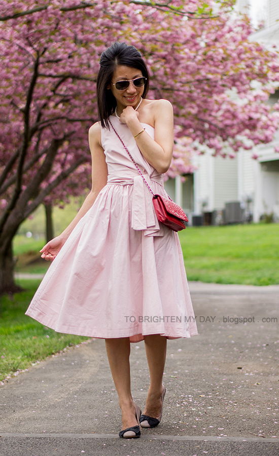 pink cutout midi dress, red crossbody bag, bow ballerina flats