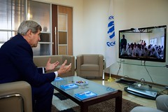 U.S. Secretary of State John Kerry speaks with students at the Dadaab Refugee Camp - largely inhabited by displaced Somalis - as he used he spoke with them via video conference while focusing on refugee matters while visiting Nairobi, Kenya, on May 4, 2015. [State Department Photo/Public Domain]