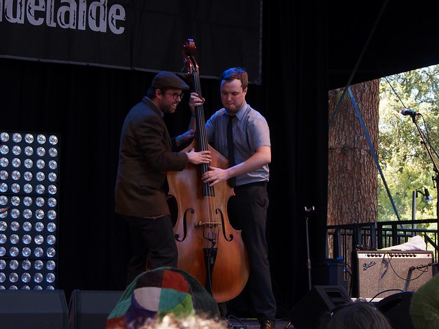 Two musicians both playing the double bass at the same time