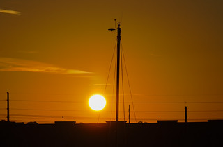 Sunrise behind the sailboat mast above Maximo marina St. Petersburg, Florida