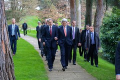 U.S. Secretary of State John Kerry and British Foreign Secretary Philip Hammond chat during a walk on March 30, 2015, in Lausanne, Switzerland, during a break in negotiations with Iranian officials about the future of their country's nuclear program. [State Department photo/ Public Domain]