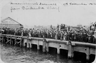 Crowd bidding farewell in the rain on Pinkenba Wharf, Brisbane