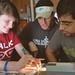 Students Sheena Hoagland (left), Fernando Torres and Brody Hajebian work together on tracing light rays in Physics II.