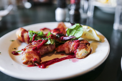 Large Shrimp stufed with Jalapeno Cream Cheese, Wrapped in Bacon, Broiled and Drizzled w/ Red Currant Coulis - Bertha's Mussels