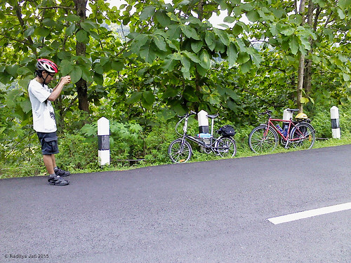 Taking Photograph of His Bike