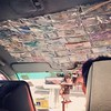 Taxi driver had all kinds of currency on his roof