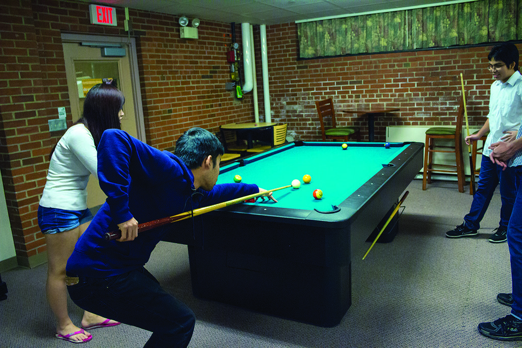 ... Students Spent A Relaxing Saturday Evening At The Pool Table In One Of  Magill Hallu0027s Basement ...