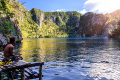 Swimming and snorkeling in the Kayangan Lake, Coron Island, Philippines