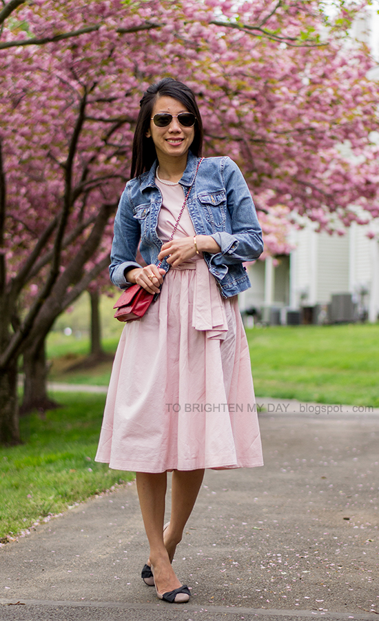 denim jacket, pink cutout midi dress, red crossbody bag, bow ballerina flats