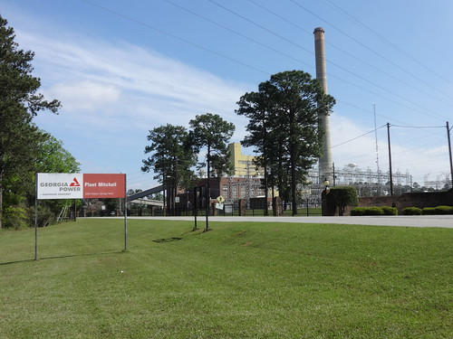 Plant Mitchell with sign, Doughtery County