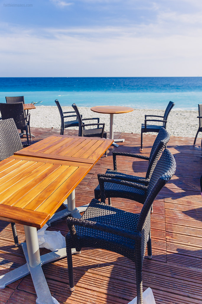 Restaurant tables by the Mediterranean sea