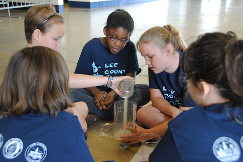 A group of students building a mini-filtration system