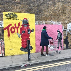 street artist(0.0), art(1.0), wall(1.0), street art(1.0), road(1.0), mural(1.0), graffiti(1.0), street(1.0), infrastructure(1.0),