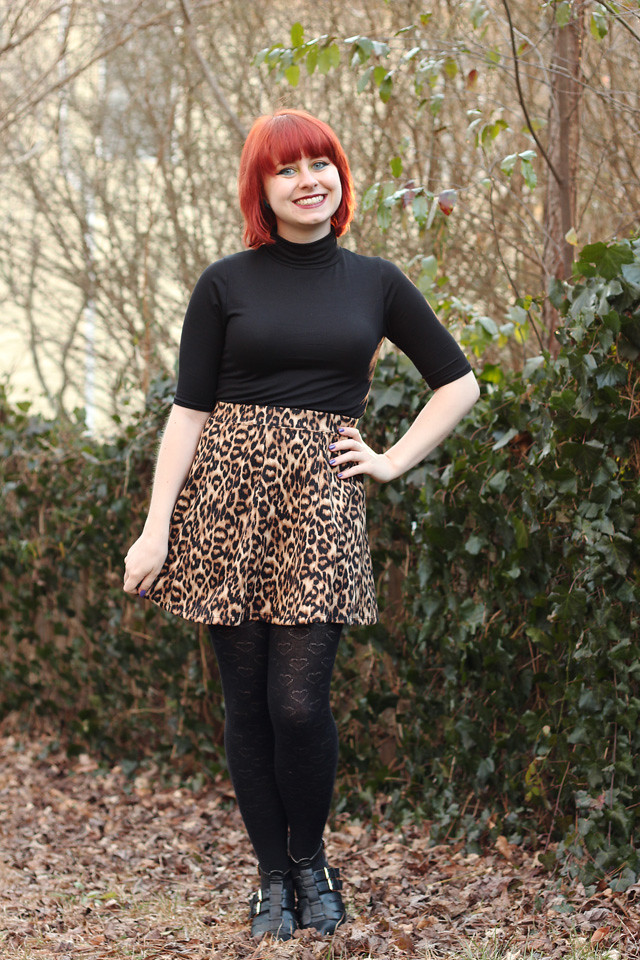 Leopard Print Neoprene Skater Skirt, Turtleneck T-shirt, Heart Print Tights, and Pointed Cutout Boots