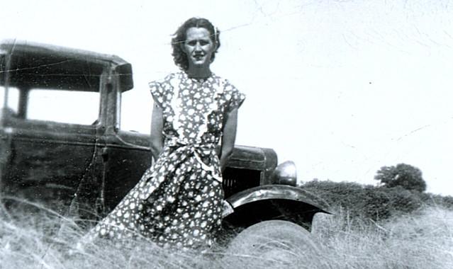 Rachel Faye Roork in front of 1930's Model T?