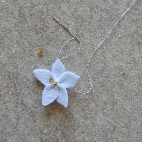 Step 6: Arrange petals and attach beads